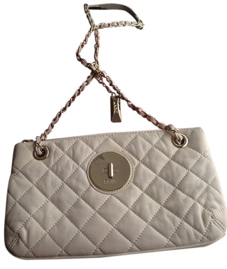 Preload https://item4.tradesy.com/images/dkny-cross-body-bag-one-cream-white-and-one-black-1987263-0-0.jpg?width=440&height=440