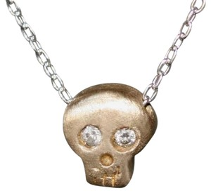 MichelleChangJewelry Baby Skull Necklace in 14K Yellow Gold with Diamonds on Silver Chain