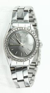 Rolex * ROLEX LADIES DIAMOND BEZEL DATEJUST WATCH (vintage and collectible)