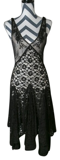 Preload https://item2.tradesy.com/images/free-people-black-mid-length-formal-dress-size-4-s-1988876-0-0.jpg?width=400&height=650