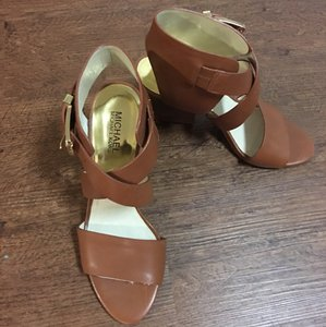 MICHAEL Michael Kors Leather Gold Hardware Brown Wedges