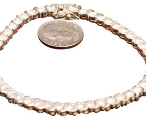 Bella & Chloe REDUCED!!! FREE SHIPPING!! Sterling Silver Tennis Zirconium Bracelet From Bella & Chloe Silver. It is 7.5 inches. Tiffany Inspired.