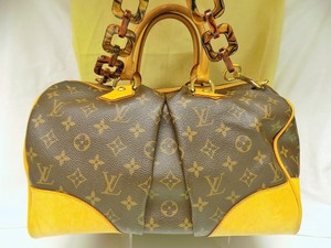 Louis Vuitton Duffel Bandouliere Brown Travel Bag