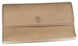 Chanel chanel gold brown tri-fold wallet.
