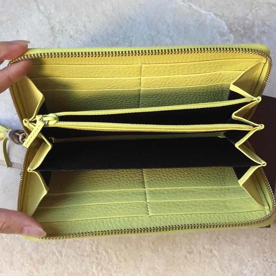 945712d51c Gucci Yellow Bamboo Tassel Leather Zip Around Wallet - Tradesy