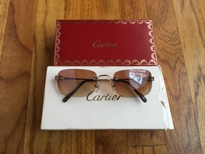Cartier CARTIER Gold Rimless Women's Sunglasses