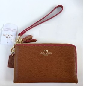 Coach Wristlet in Saddle/Dahlia