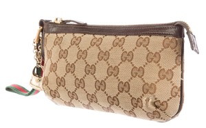 Gucci Beige Guccissima embossed leather Gucci pochette