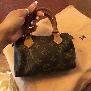 Louis Vuitton Mono Clutch