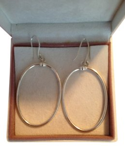 FREE SHIPPING!! Sterling Silver Dangle Hoop Earrings from Overstock Silver.Dangle 2.5 inches. These look good on everyone!