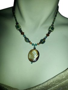 Necklace with mother of pearl, metal, crystal and ceramic beads