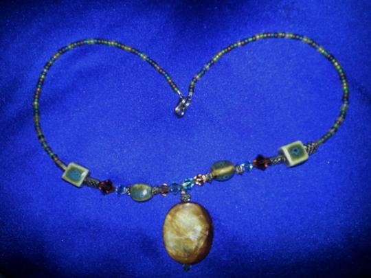 Other Necklace with mother of pearl, metal, crystal and ceramic beads