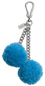 Coach COACH SHEARLING pom pom bag charm In Peacock color New!!