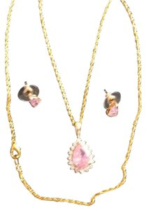 Gold necklace with pink stone