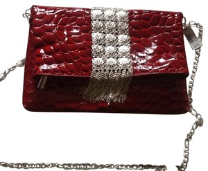 White House | Black Market Red Clutch