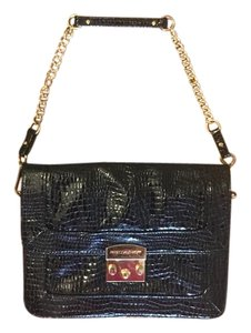 Rebecca Minkoff Black with gold metal Clutch