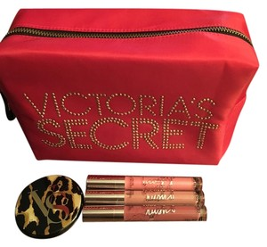 Victoria's Secret With 3 new lipgloss and mirror..... comes with free surprise gift