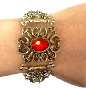 Other Gold-tone Bracelet with red stone in center