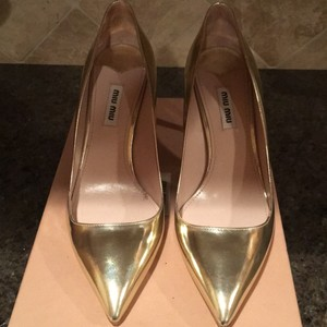 Miu Miu Gold Pumps