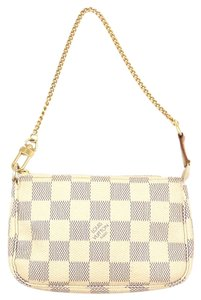 Louis Vuitton Damier Canvas Mini Leather Wristlet in Ivory