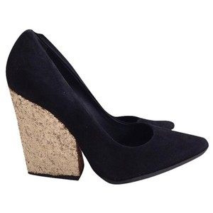dae653c9a073 ... Point Heels 8  38 Pumps.  150.00. US 8. Sold Out. Alice + Olivia Black Gold  Pumps
