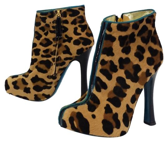 Preload https://item3.tradesy.com/images/dsquared2-leopard-print-calf-hair-w-teal-trim-bootsbooties-size-us-7-1997457-0-0.jpg?width=440&height=440