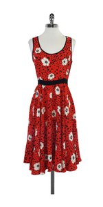 Nieves Lavi short dress Red Orange Black & White Floral on Tradesy