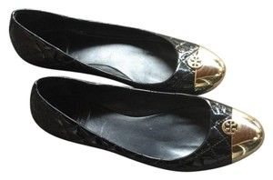 Tory Burch shiny black and gold Flats