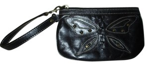 Fossil studded leather wristlet