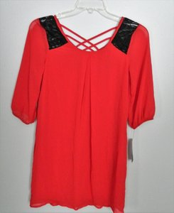 A. Byer short dress Red and Black Lace Up Lace on Tradesy
