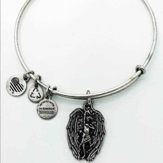 Preload https://item1.tradesy.com/images/alex-and-ani-silver-guardian-of-strength-bangle-bracelet-20000600-0-0.jpg?width=440&height=440