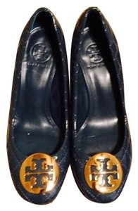 Tory Burch Timberwolf/bronze color is blue Wedges