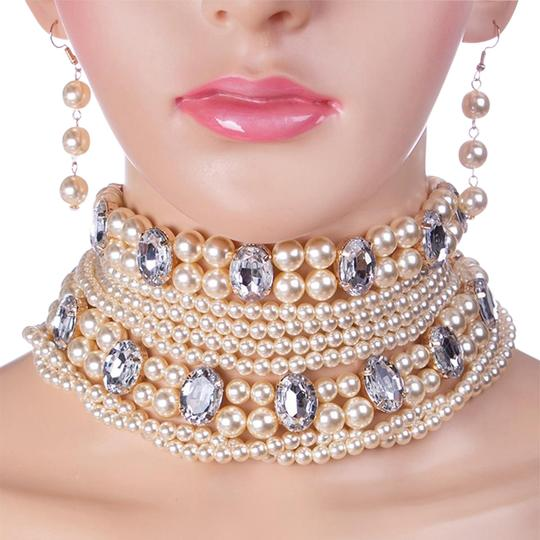 Preload https://item4.tradesy.com/images/cream-gold-clear-all-rhinestone-crystal-accent-pearl-choker-2016-trend-necklace-20000988-0-1.jpg?width=440&height=440