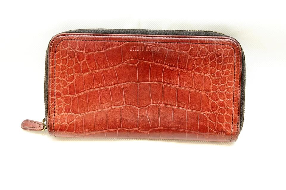 1770ac6b1124 Miu Miu Red Crocodile Embossed Zippy Wallet - Tradesy