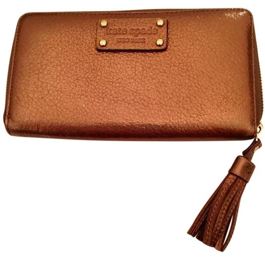 Preload https://item2.tradesy.com/images/kate-spade-copper-metallic-lacey-with-tassel-wallet-20002066-0-2.jpg?width=440&height=440