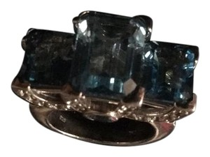 Neiman Marcus. Beak and stone silver plated. Blue topaz is sparklingyou have to try it