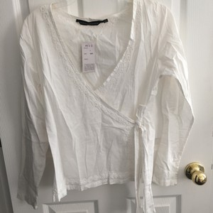 White embroidered wrap top size one size $20.00 Top