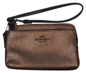 Coach Wristlet in Brass