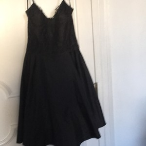 BCBG Black cocktail dress with lacy top and beaded straps. Dress