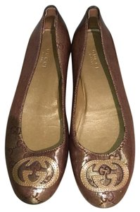 Gucci Brown and gold Flats