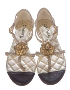 Chanel Camellia Strappy Quilted Gold Hardware Interlocking Cc Gold/Black Sandals