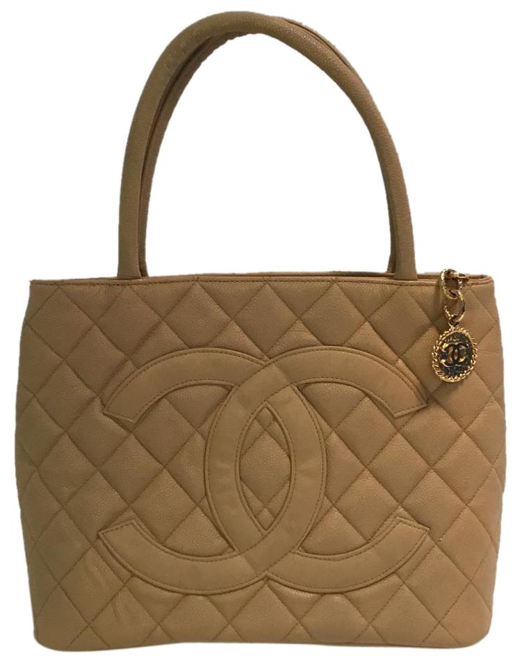 152bb35bb085 Chanel With Gold Toned Hardware Beige Medallion Caviar Leather Tote ...