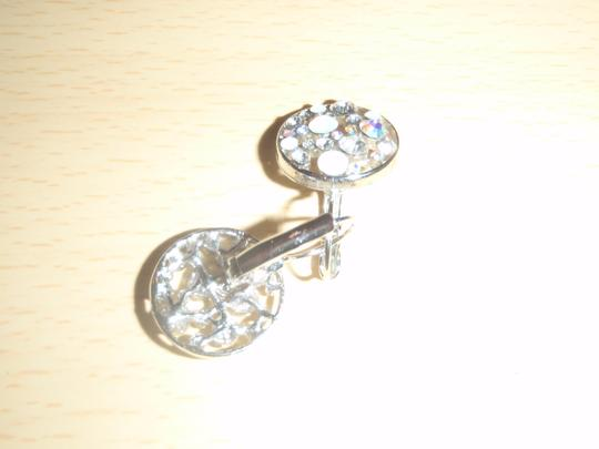 Unknown Custom earring with Crystal at the circle.