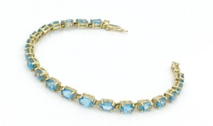 Other 11.22Ct Oval Shape Blue Topaz 14Kt Yellow Gold Tennis Bracelet