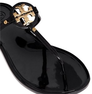 Tory Burch Black and gold Sandals