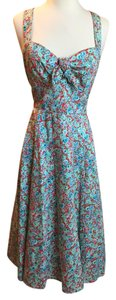London Times short dress Blue, Red, Multicolor Tea Length Crisscross Strap on Tradesy