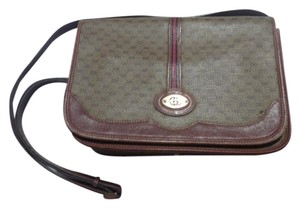Gucci Great For Everyday Gold Hardware Popular Style Excellent Condition brown leather/small G logo print in shades of brown with red/green accents Messenger Bag