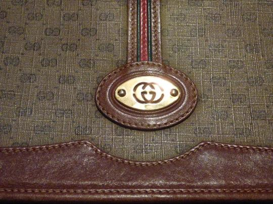 Gucci Great For Everyday Gold Hardware Popular Style Excellent Condition brown leather/small G logo print in shades of brown with red/green accents Messenger Bag Image 1