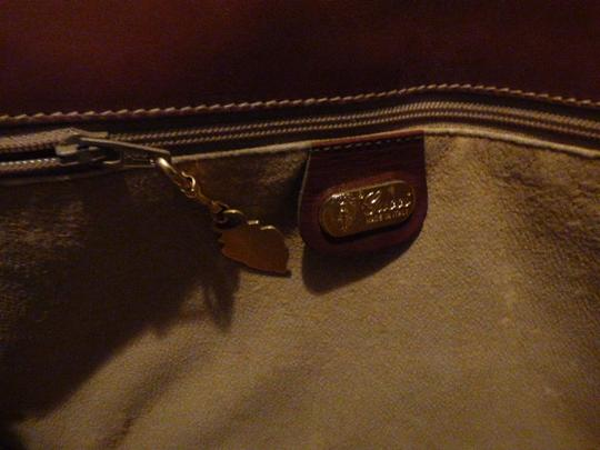 Gucci Great For Everyday Gold Hardware Popular Style Excellent Condition brown leather/small G logo print in shades of brown with red/green accents Messenger Bag Image 11