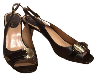 Cole Haan Dark Brown with Gold accents. Pumps